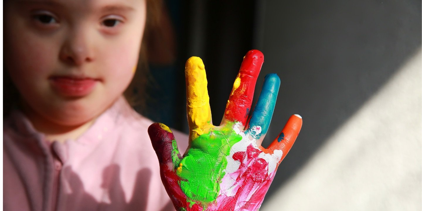 Picture of girl with painted hand in the air
